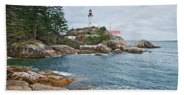 Point Atkinson Lighthouse And Rocky Shore Hand Towel