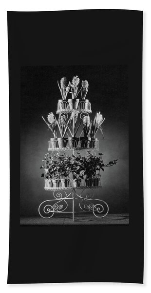 Potted Flowers On A Wrought Iron Stand Bath Towel