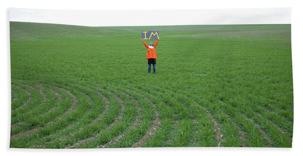 Woman In Big Field Holds Up Sign Bath Towel