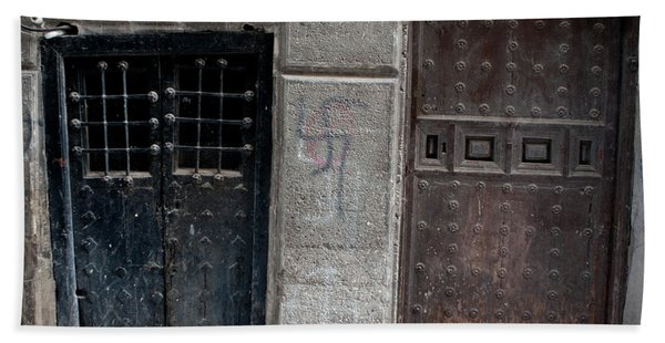 Bath Towel featuring the photograph Medieval Doors Evil Graffiti by Lorraine Devon Wilke