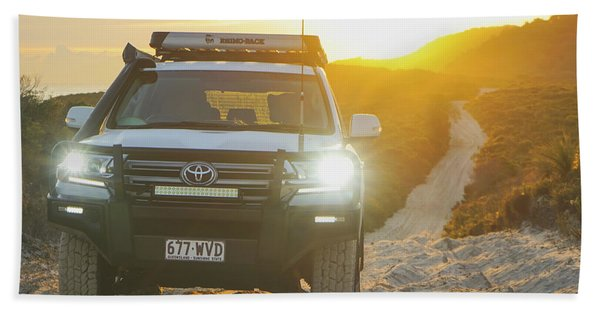 4wd Car Explores Sand Track In Early Morning Light Bath Towel