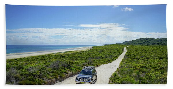 4wd Car Exploring Remote Track On Sand Island Bath Towel