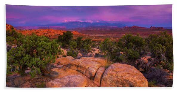 Hand Towel featuring the photograph A Sunset Over Arches by John De Bord