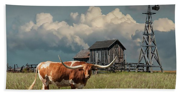 Longhorn Steer In A Prairie Pasture By Windmill And Old Gray Wooden Barn Hand Towel