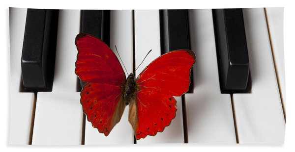 Red Butterfly On Piano Keys Hand Towel