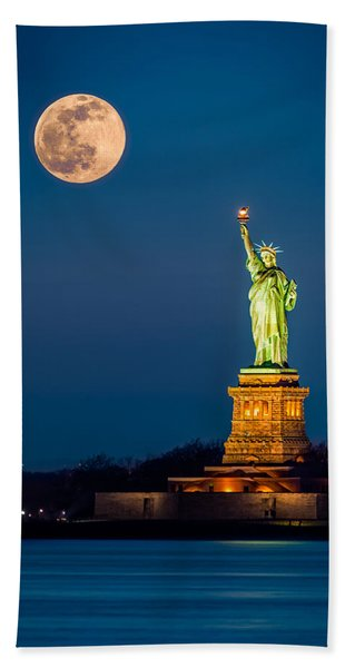 Hand Towel featuring the photograph Statue Of Liberty And A Rising Supermoon In New York City by Mihai Andritoiu