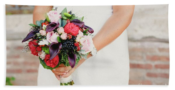 Bridal Bouquet Held By Her With Her Hands At Her Wedding Bath Towel
