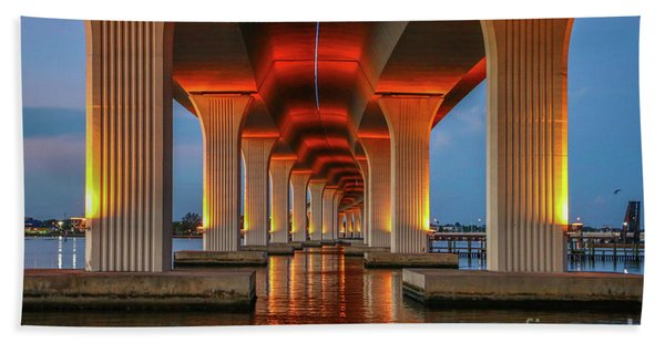 Bath Towel featuring the photograph Orange Light Bridge Reflection by Tom Claud