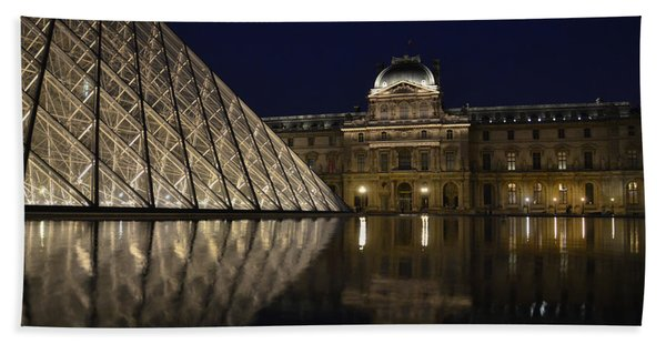 The Louvre Palace And The Pyramid At Night Beach Towel