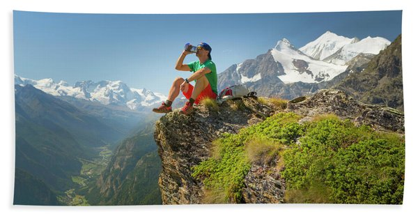 A Hiker Is Drinking From A Water Bottle Beach Towel