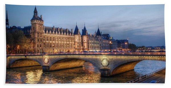 Conciergerie And Pont Napoleon At Twilight Beach Towel