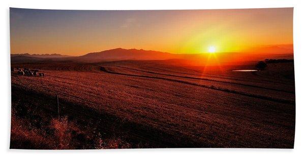 Golden Sunrise Over Farmland Beach Towel