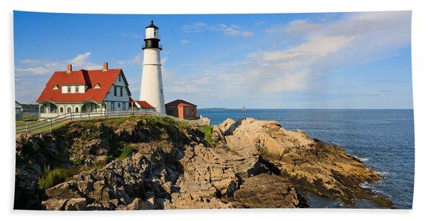 Lighthouse In The Sun Beach Towel