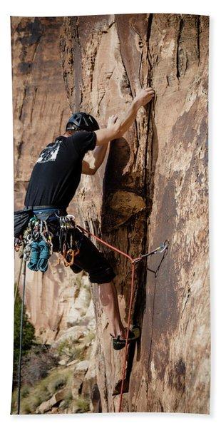 Man Climbing In Sandstone Tall Rock Beach Towel