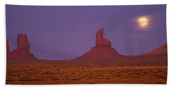 Moon Shining Over Rock Formations Beach Towel