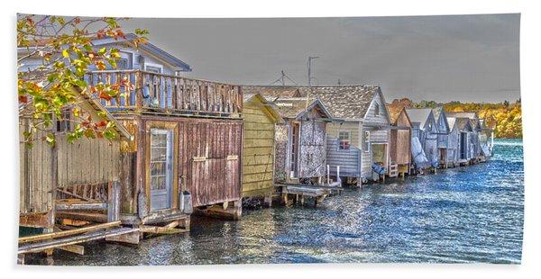 Row Of Boathouses Beach Towel