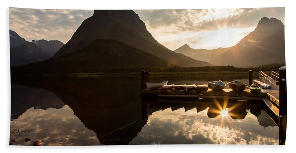 Swiftcurrent Lake Boats Reflection And Flare Beach Towel