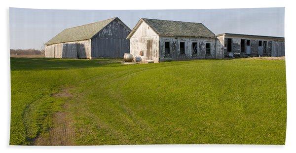 Three Weathered Farm Buildings Beach Towel