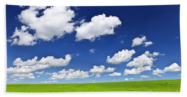 Green Rolling Hills Under Blue Sky Beach Towel