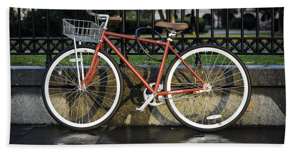 A Red Bicycle Near Jackson Square, New Orleans, Louisian Beach Towel
