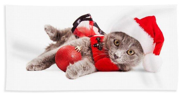 Adorable Christmas Kitten Over White Beach Towel