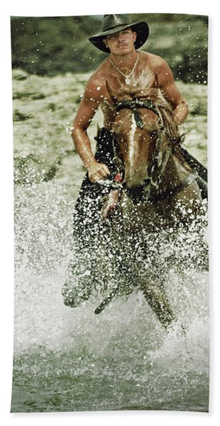 Cowboy Riding Horse Across The River Beach Towel