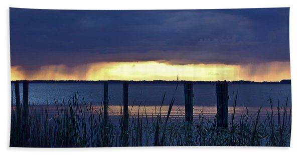 Distant Storms At Sunset Beach Towel