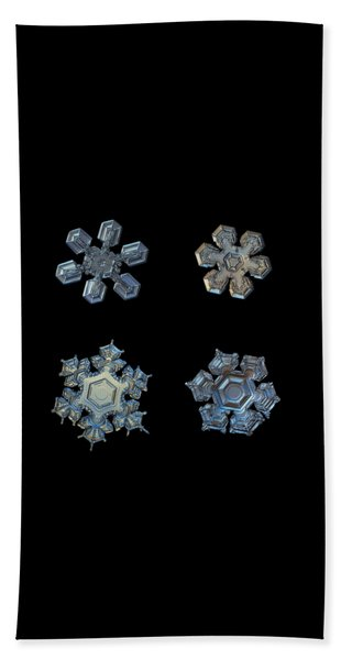 Four Snowflakes On Black 2 Beach Towel