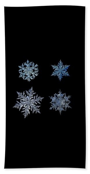 Four Snowflakes On Black Background Beach Towel