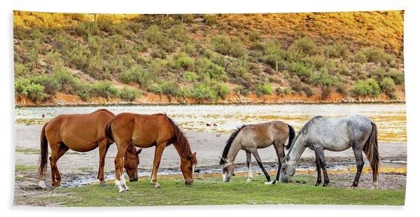Four Wild Horses Grazing Along Arizona River Beach Towel