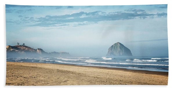 Beach Towel featuring the photograph Haystack Rock Pacific City by Tom Singleton