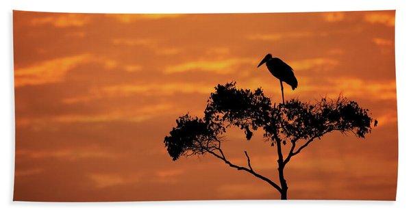 Maribou Stork On Tree With Orange Sunrise Sky Beach Towel