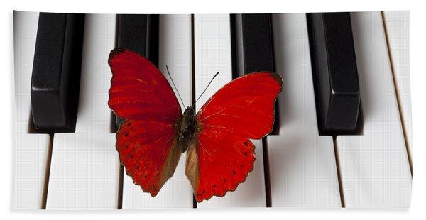 Red Butterfly On Piano Keys Beach Towel