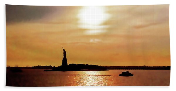 Statue Of Liberty At Sunset Beach Towel