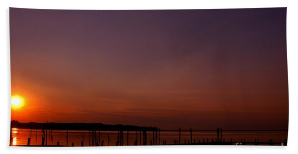 The Sun Sets Over The Water Beach Towel