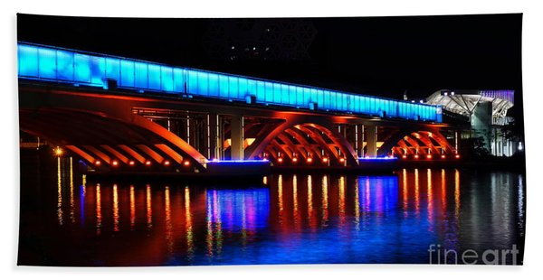Evening View Of The Love River And Illuminated Bridge Beach Towel