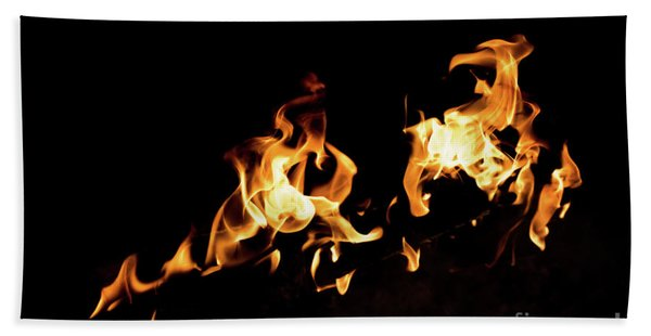 Flames In The Fire Of A Red And Yellow Barbecue. Beach Towel