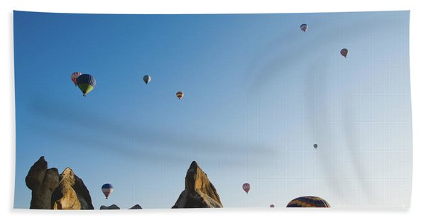 Colorful Balloons Flying Over Mountains And With Blue Sky Beach Towel