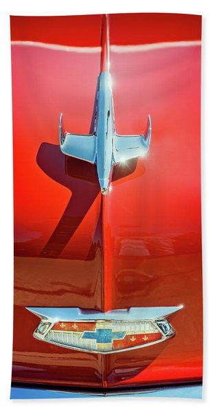 Hood Ornament On A Red 55 Chevy Beach Towel