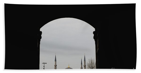 minarets in the city for the prayer of the Muslim religion Beach Towel