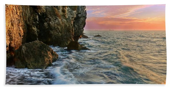 Rocky Cliffs And Waves During Sunset Beach Towel