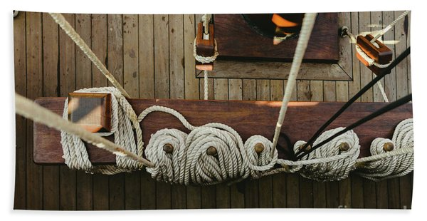 Ropes To Hold The Sails Of An Old Sailboat Rolled. Beach Towel