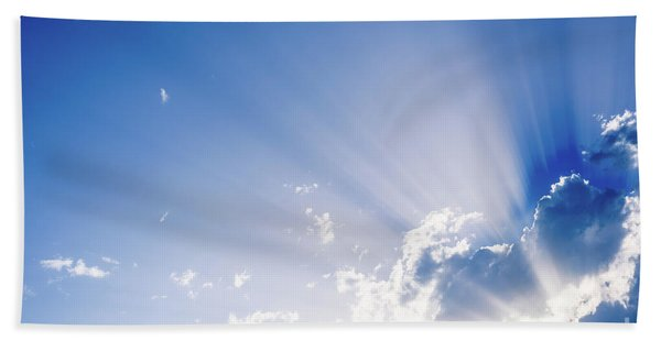 Sunbeams Rising From A Large Cloud In Intense Blue Sky On A Summer Afternoon Beach Towel
