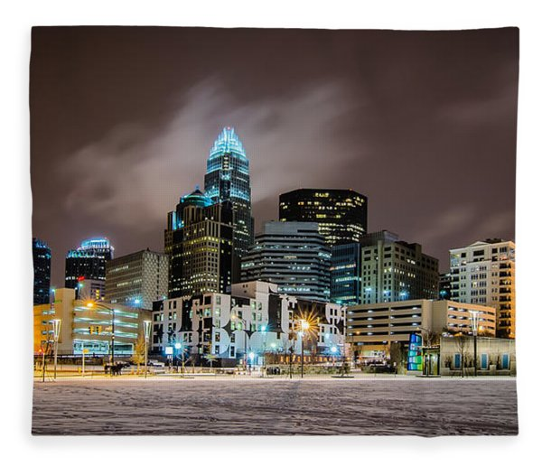 Fleece Blanket featuring the photograph Charlotte Queen City Skyline Near Romare Bearden Park In Winter Snow by Alex Grichenko