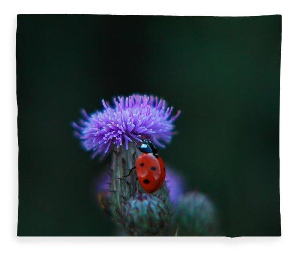 A Lady Bug Climbing A Thistle Fleece Blanket