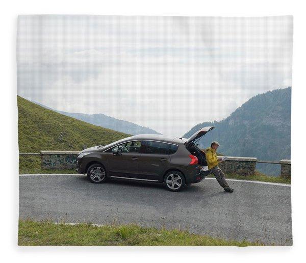 Man Rests On Trunk Of Car On Mountain Fleece Blanket