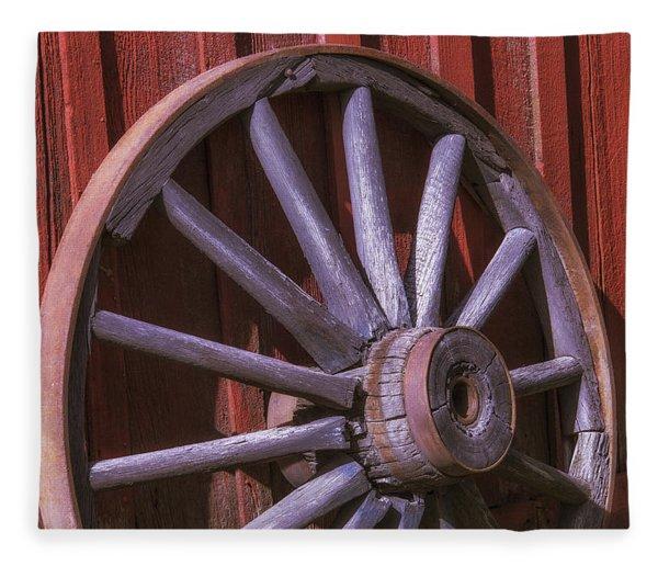 Old Wagon Wheel Leaning Against Barn Fleece Blanket