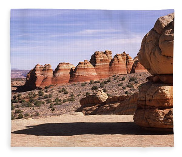 Rock Formations On An Arid Landscape Fleece Blanket