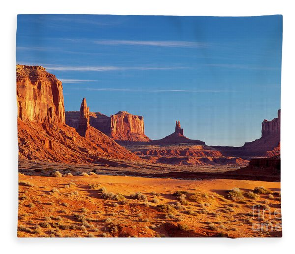 Fleece Blanket featuring the photograph Sunrise Over Monument Valley by Brian Jannsen