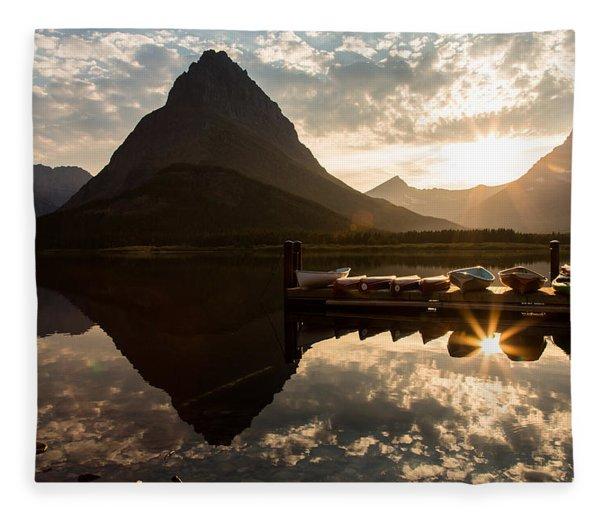 Swiftcurrent Lake Boats Reflection And Flare Fleece Blanket